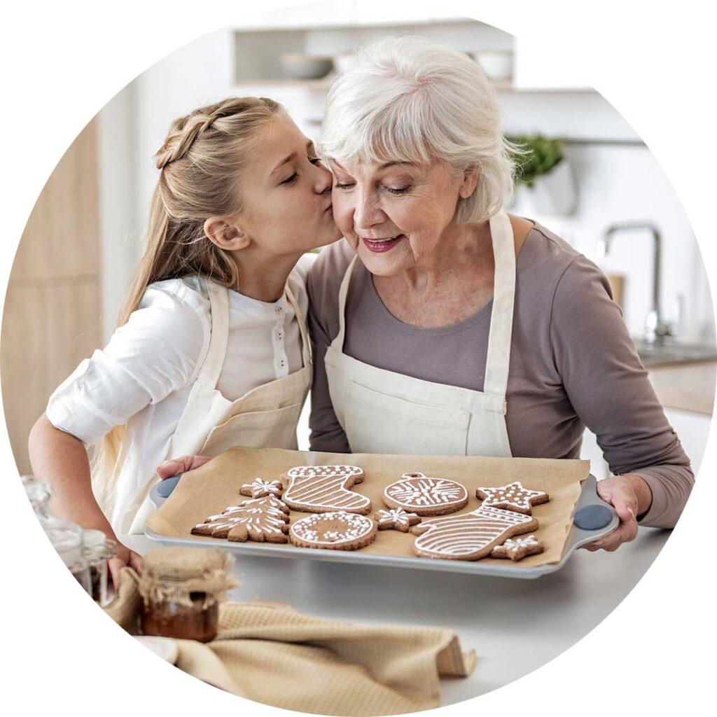 child kisses grandma